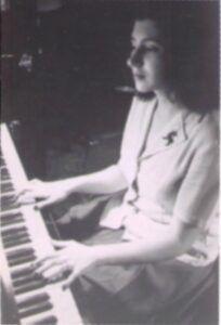 Ruth at piano.